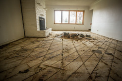 Living room with flooring that has been removed