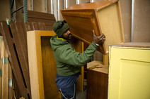 Man carrying cabinet
