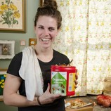 Woman holding small organics recycling container