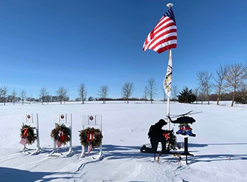 Photo of a memorial to the three National Guard members created at the helicopter crash site south of Marty.