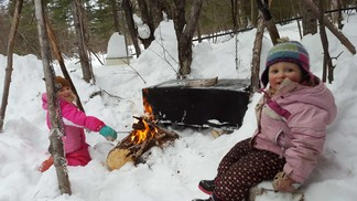 Young girls by campfire
