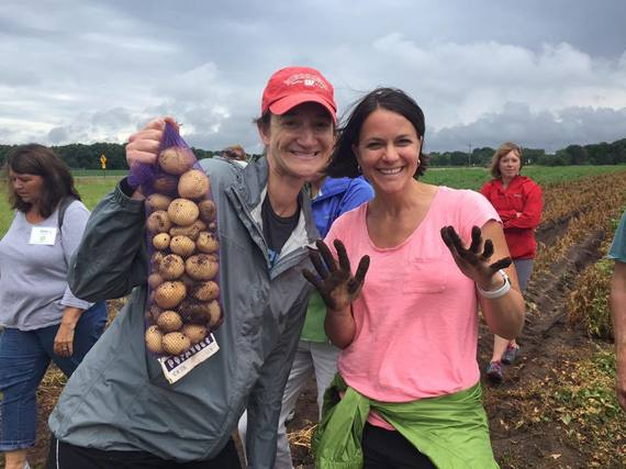 teacher harvesting potato