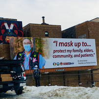 AICHO billboard: I mask up to protect my family, elders, community, and patients.