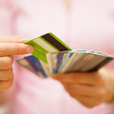 Woman holding various credit cards