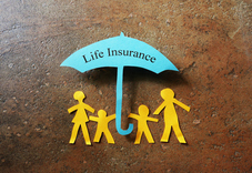 family cut out with colorful cardstock paper with an umbrella about then with the words life insruance.
