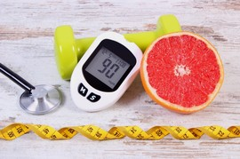 Diabetes testing supplies, weight and grapefruit.