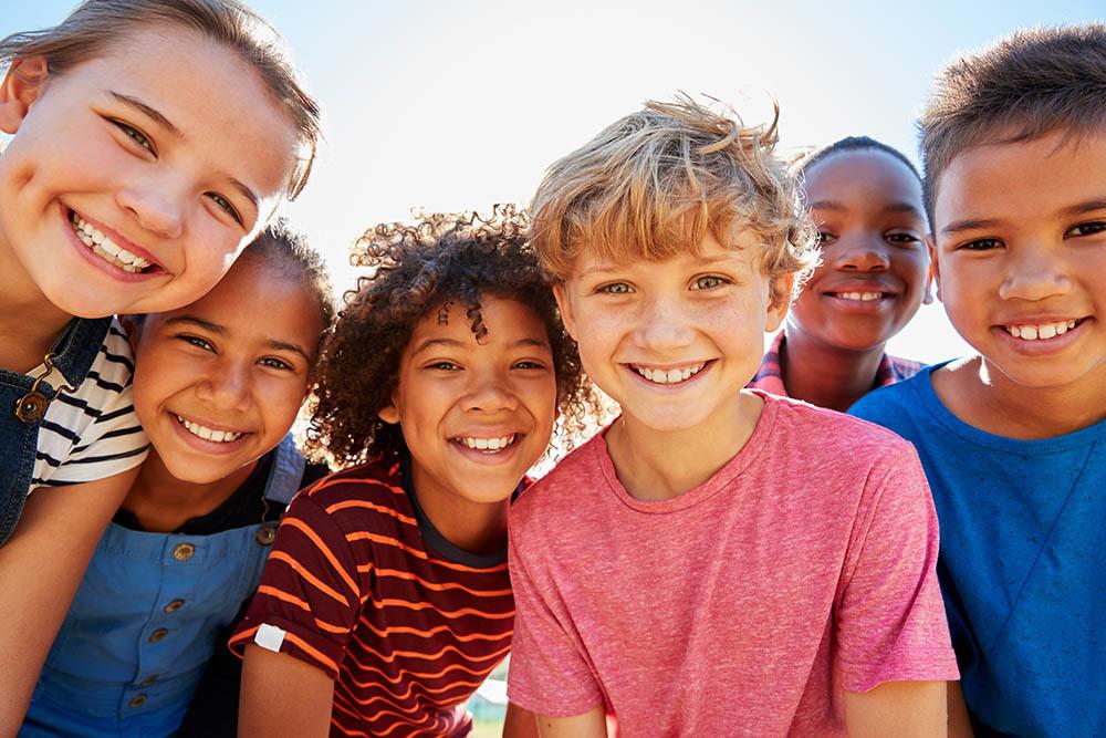 Photo of smiling children.