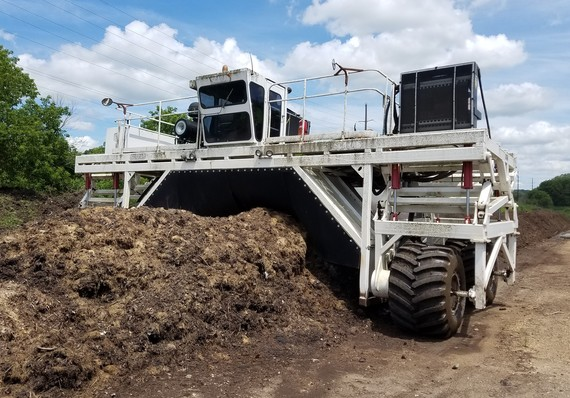 Turning compost at Olmsted County Compost Site