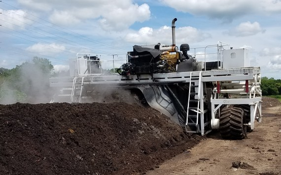 Turning compost at the Olmsted County Compost Site