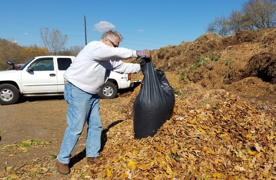 Resident drops leaves off at the Compost Site