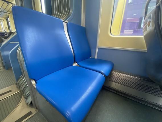 Plastic seats on a METRO Blue Line train.