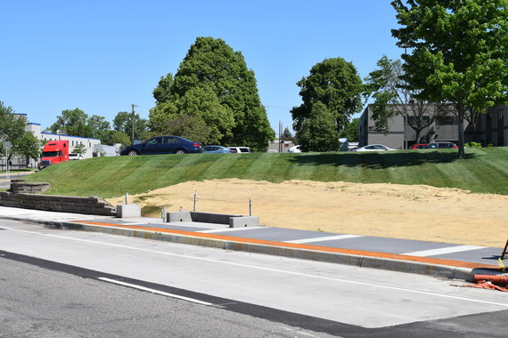 A nearly completed station at 7th and Bryant in N. Minneapolis. Grass seed is being completed behind the platform