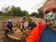 Volunteers with face masks posing at a cleanup site.