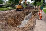 A tree trench under construction on a residential street.