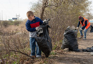 Child and woman picking up trash.