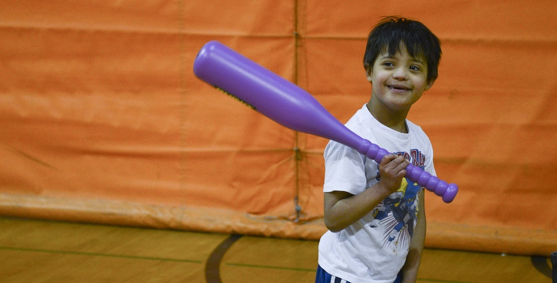 Kids holding purple baseball bat during an adaptive sports program at Matthews Recreation Center