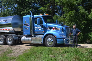 Driver Dan Hund of Caledonia Haulers poses with their new truck