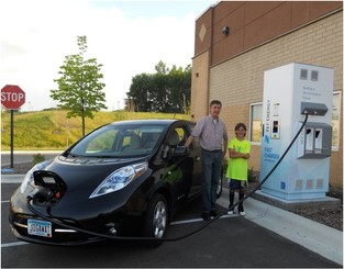 Family charges their electric vehicle