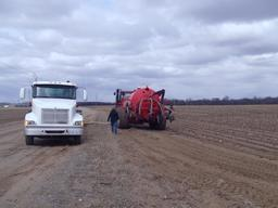 Biosolids from St. Cloud being transferred to a field applicator