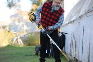 Person using electric landscaping equipment