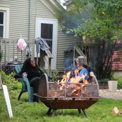 People and a backyard fire