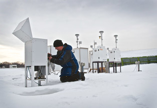 Person collecting data from an air quality monitor