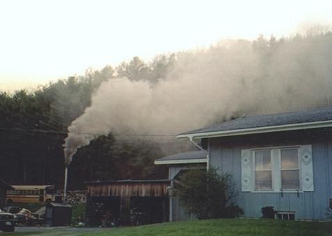 Outdoor wood boiler producing a lot of smoke