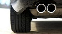 Car bumper with dual tailpipes