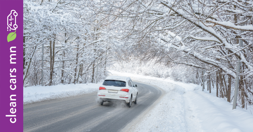 White car driving on snowy wooded highway
