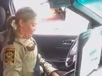 Female deputy in sheriff's office vehicle
