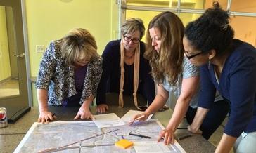 women reviewing map