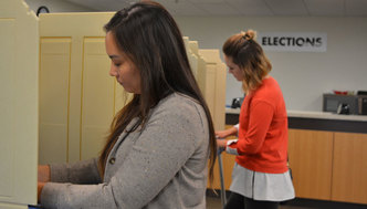 Residents voting at early voting location.
