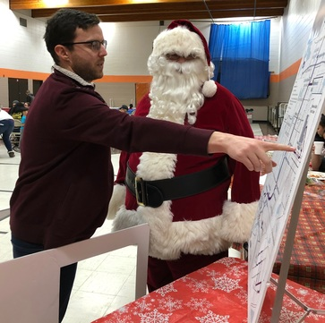 A Rush Line planner discusses Rush Line BRT with none other than Santa Claus