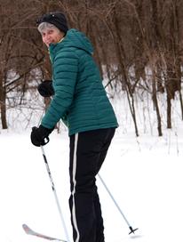 Adult cross country skiing at Tamarack Nature Center.