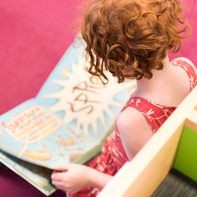 young girl reading book