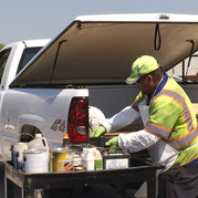 man unloading household hazardous waste