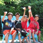 Four teens eating ice cream