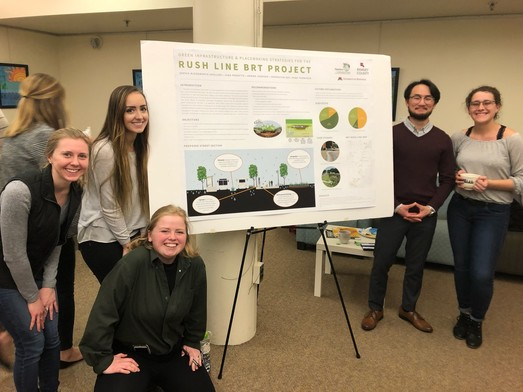University of Minnesota students pose in front of their presentation board about Rush Line stormwater management strategies.