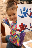Girl finger painting at county park