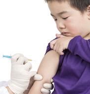Boy getting a vaccination (shot) from a healthcare provider