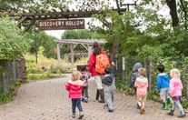 Children walking into Discovery Hollow at Tamarack Nature Center