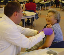 woman getting flu shot