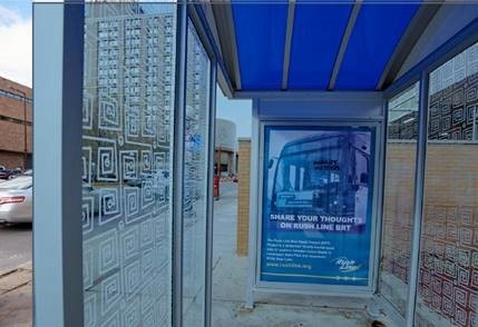 "Photo of a bus shelter with a Rush Line banner that says ""Share your thoughts on Rush Line BRT"""