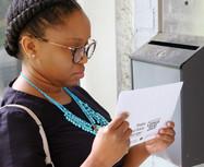 woman looking at 2020 census