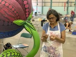 artist working on rose sculpture