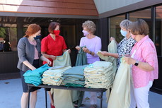 Volunteers sew gowns for Care Center
