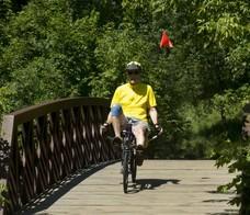 Resident biking on trail