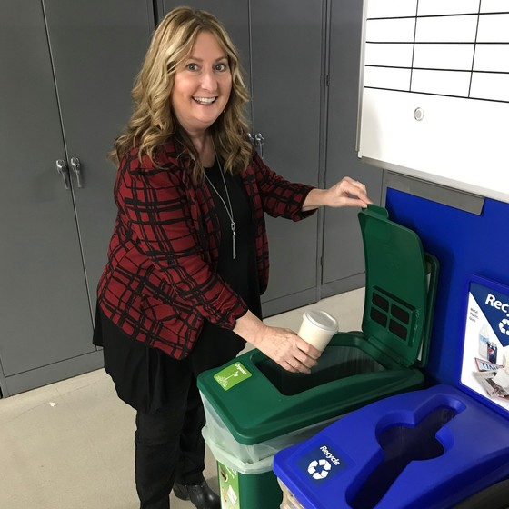 Photo of a woman recycling