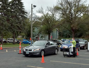 Cars drive through the household hazardous waste collection site at Our Lady of Guadalupe Church.