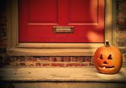 Jack-o-lantern on a door step